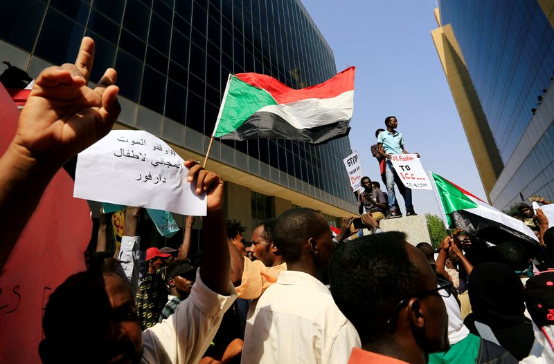 FILE PHOTO: Protesters attend a rally calling for a stop to killing in Darfur and stability for peace, next to a building in front of Ministry of Justice in Khartoum