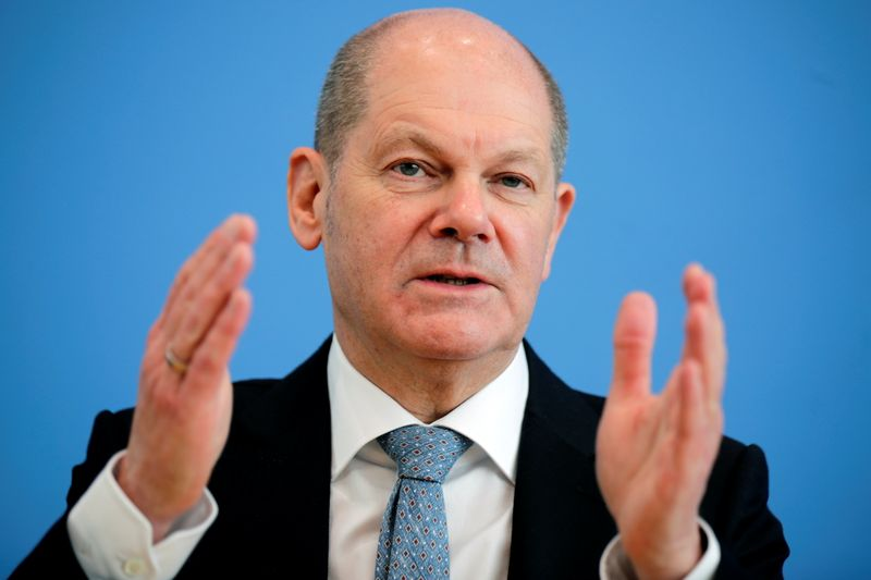 FILE PHOTO: German Finance Minister Scholz holds a news conference in Berlin