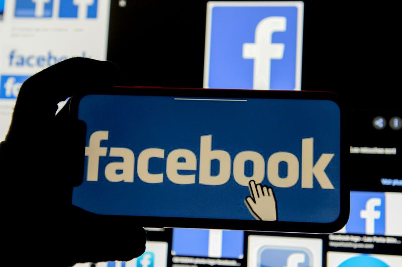 FILE PHOTO: The Facebook logo is displayed on a mobile phone