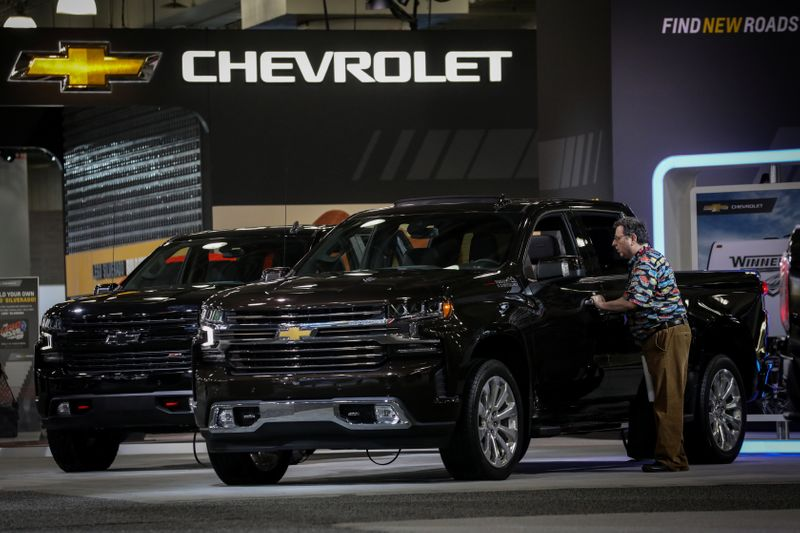 A man looks at a Chevrolet Silverado pickup truck during the 2019 New York International Auto Show in New York