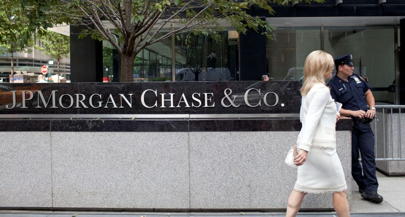 FILE PHOTO: A woman walks past JPMorgan Chase & Co's international headquarters on Park Avenue in New York