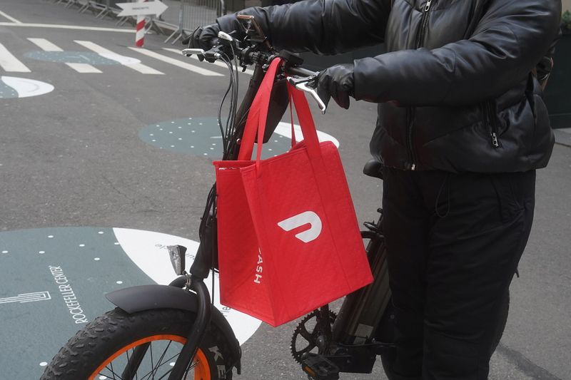 A DoorDash delivery person is pictured on the day they hold their IPO