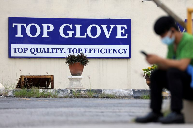 FILE PHOTO: Top Glove logo is pictured outside a factory in Klang