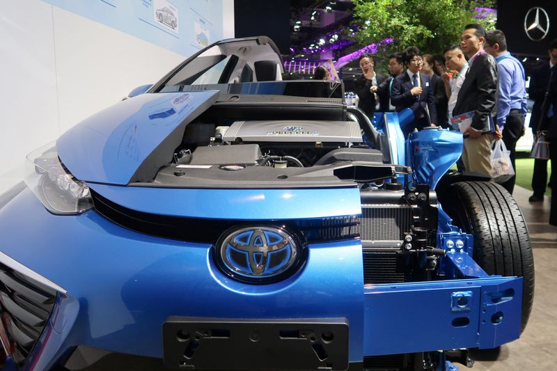 FILE PHOTO: Visitors look at a display of Toyota's Mirai hydrogen fuel-cell vehicle during the second China International Import Expo (CIIE) in Shanghai