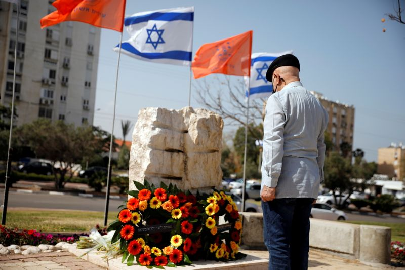 A man stands still as a two-minute siren marking the annual Israeli Holocaust Remembrance Day is heard in Ashkelon
