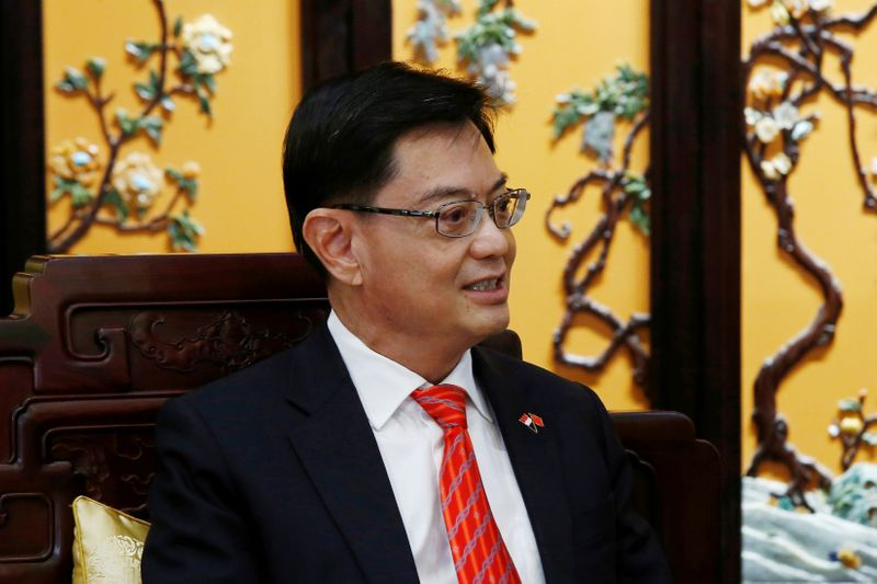 FILE PHOTO: Singapore's Deputy Prime Minister Heng Swee Keat attends a meeting at Diaoyutai state guesthouse in Beijing