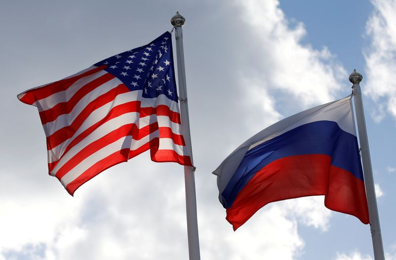 FILE PHOTO: Russian and U.S. state flags fly near a factory in Vsevolozhsk