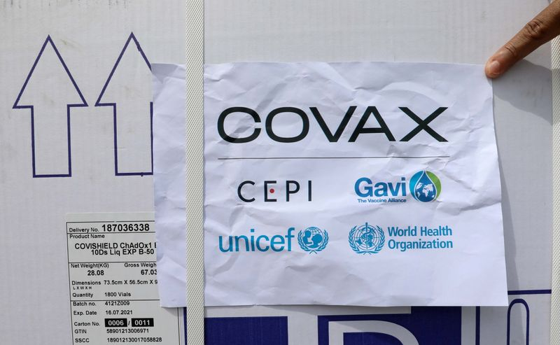 FILE PHOTO: Workers offload the AstraZeneca/Oxford vaccines under the COVAX scheme against COVID-19 at the Aden Abdulle Osman Airport in Mogadishu