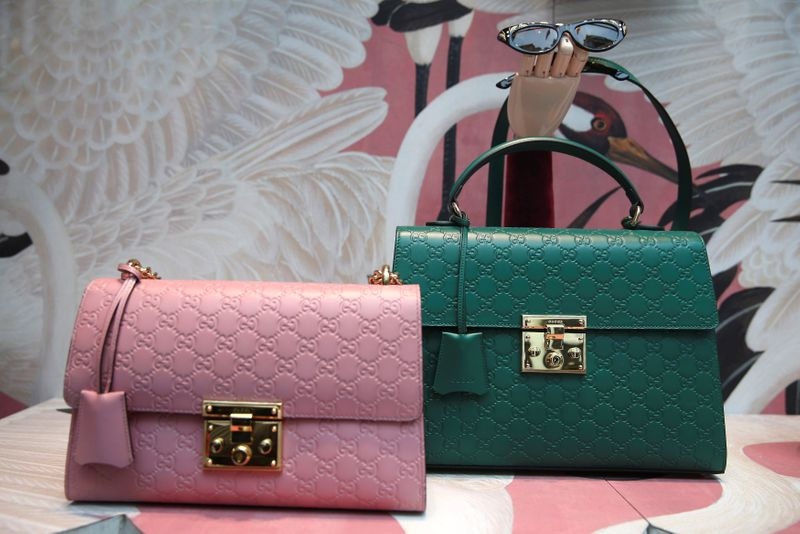 FILE PHOTO: Gucci products are displayed in the window of a store on Old Bond Street in London