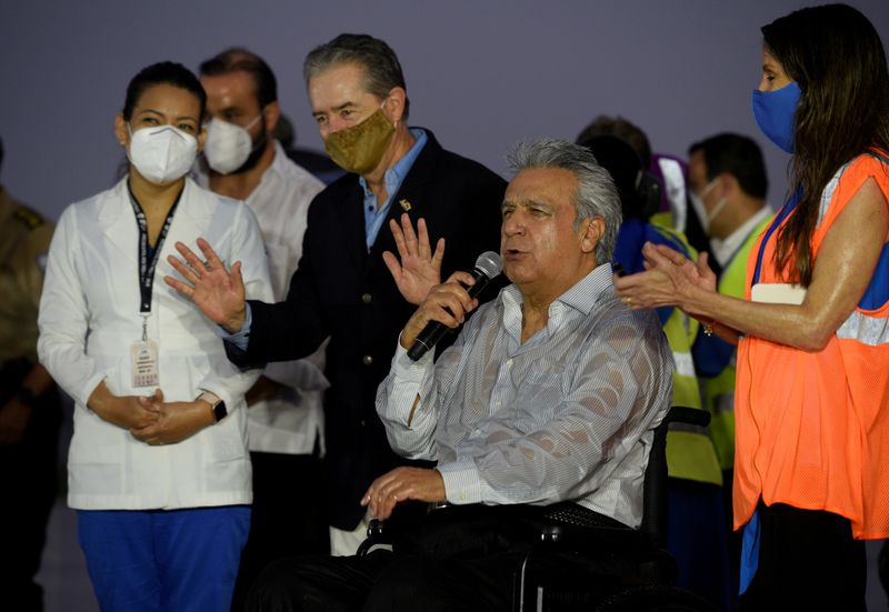 FILE PHOTO: Ecuador's President Lenin Moreno addresses the media next to Minister of Health Juan Carlos Zevallos after the arrival of a first batch of doses of COVID-19 vaccines from Pfizer, in Guayaquil