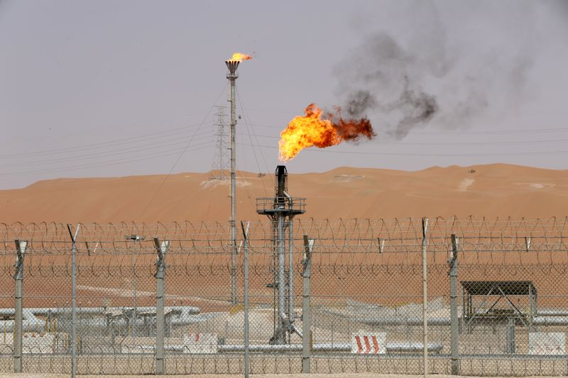 FILE PHOTO: Flames are seen at the production facility of Saudi Aramco's Shaybah oilfield in the Empty Quarter