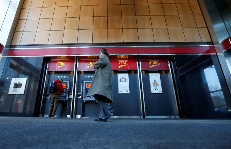FILE PHOTO: Pedestrians use the CIBC ATM machines in Montreal
