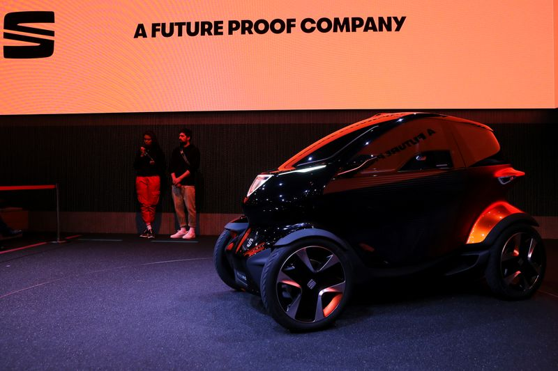 Minimo, the new all-electric a two-seater concept vehicle by the Spanish car-maker SEAT, is displayed inside company's booth after being unveiled at the Mobile World Congress in Barcelona