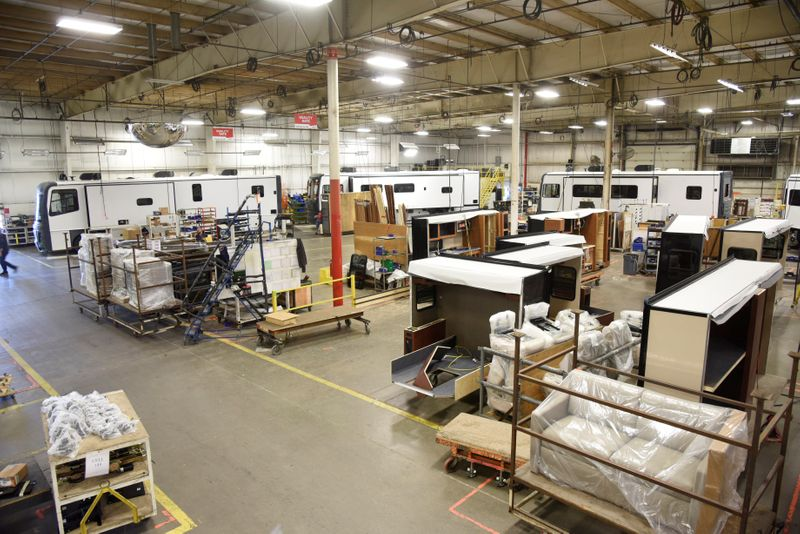 Employees work at a REV plant where they produce recreational vehicles in Decatur