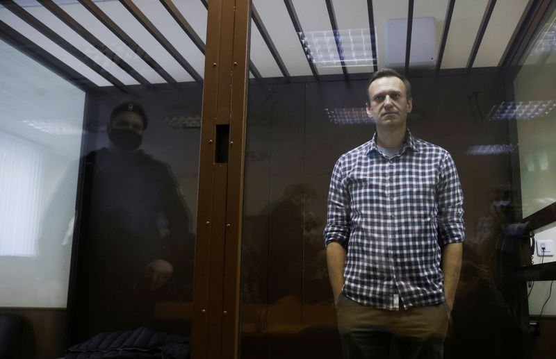 FILE PHOTO: Russian opposition politician Alexei Navalny attends a court hearing in Moscow