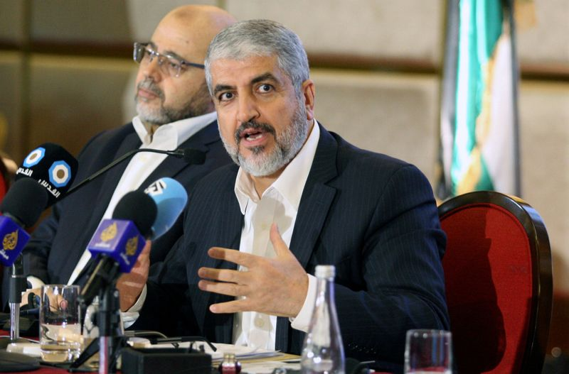 FILE PHOTO: Hamas leader Khaled Meshaal gestures as he announces a new policy document in Doha