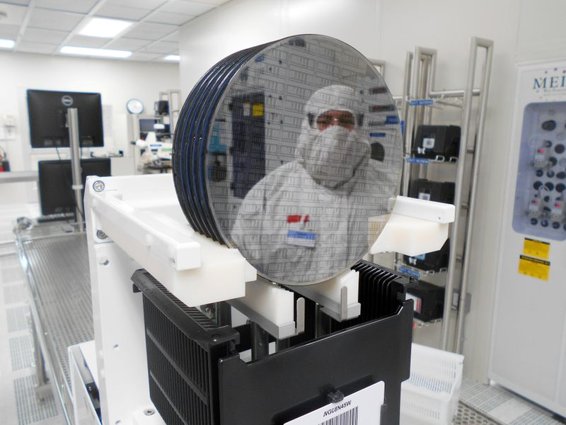 A worker is seen at a semiconductor fabrication facility owned by Dutch chipmaker NXP Semiconductors N.V. in Chandler