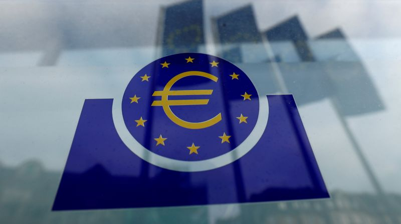 FILE PHOTO: Specialists work on a crane in front of the European Central Bank (ECB) in Frankfurt, Germany