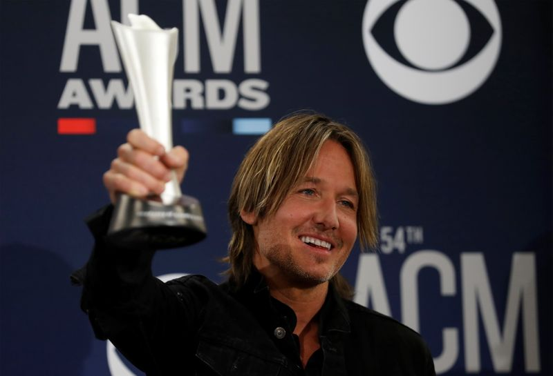 FILE PHOTO: 54th Academy of Country Music Awards – Photo Room – Las Vegas, Nevada, U.S., April 7, 2019 – Keith Urban poses backstage with his Entertainer of the Year award.
