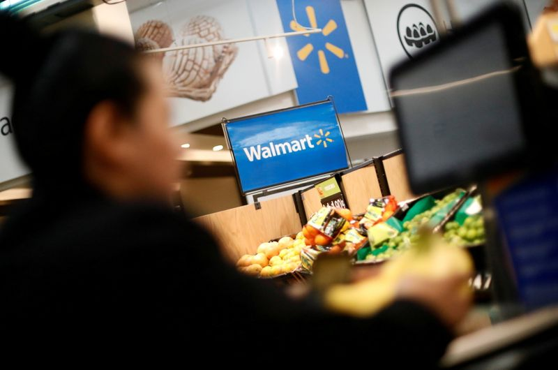 FILE PHOTO: A customer shops inside a Walmart store in Mexico City