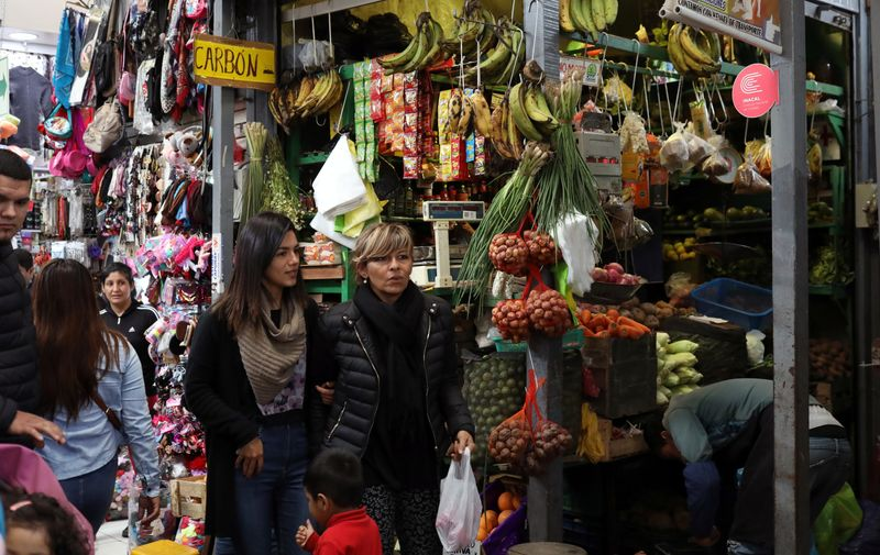 FILE PHOTO: People walk at Surco market in Lima