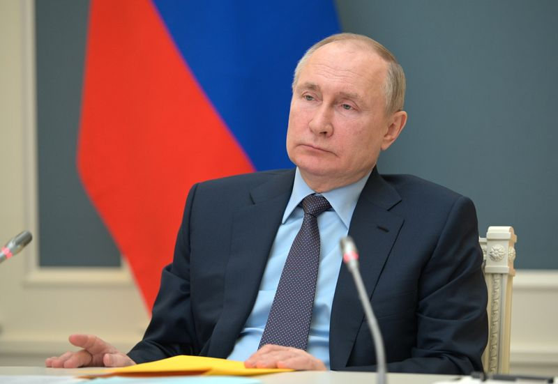 Russian President Putin attends a session of the Russian Geographical Society in Moscow