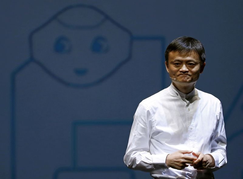 FILE PHOTO: FILE PHOTO: Jack Ma, founder and executive chairman of China's Alibaba Group, speaks in front of a picture of SoftBank's human-like robot named 'pepper' during a news conference in Chiba