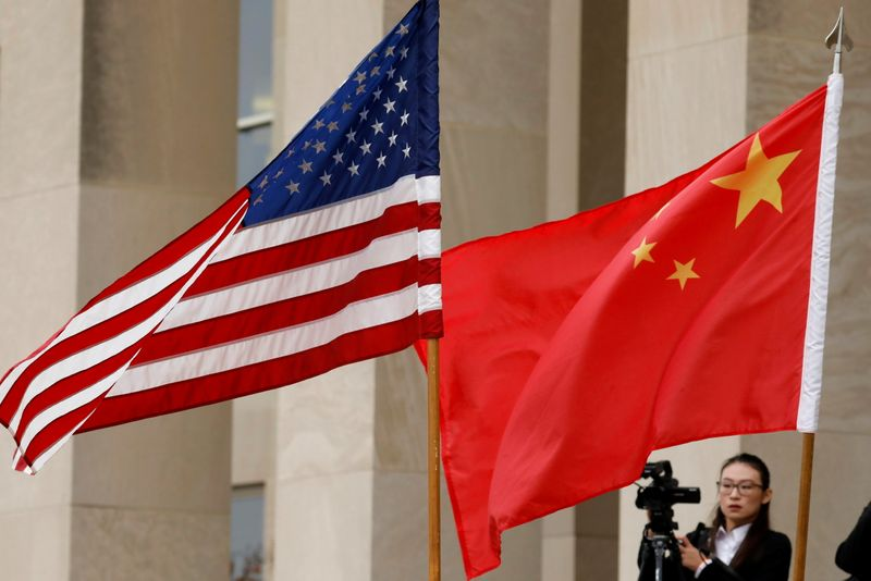 FILE PHOTO: U.S. and Chinese flags outside the Pentagon