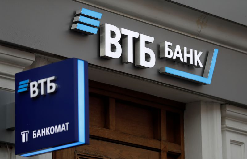Logos are on display outside a branch of VTB bank in Moscow