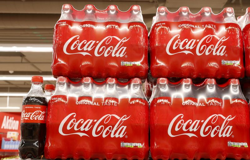 FILE PHOTO: Bottles of Coca-Cola are displayed at a supermarket of Swiss retailer Denne in Glattbrugg