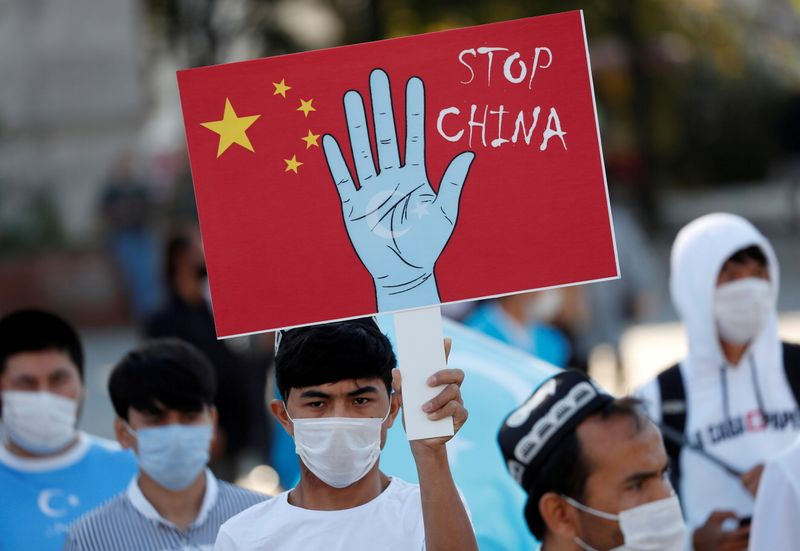 FILE PHOTO: Ethnic Uighur demonstrators take part in a protest against China, in Istanbul