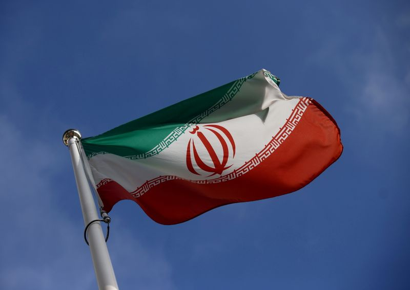 FILE PHOTO: The Iranian flag waves in front of the International Atomic Energy Agency (IAEA) headquarters, before the beginning of a board of governors meeting, amid the coronavirus disease