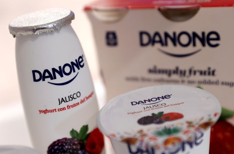 FILE PHOTO: Company logos are seen on products displayed before French food group Danone 2019 annual results presentation in Paris