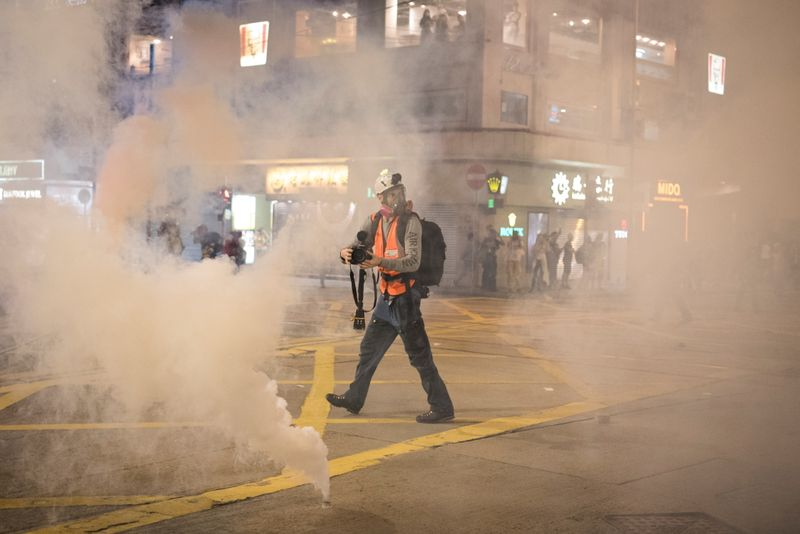 Handout photo of Norwegian filmmaker Anders Hammer filming in Hong Kong