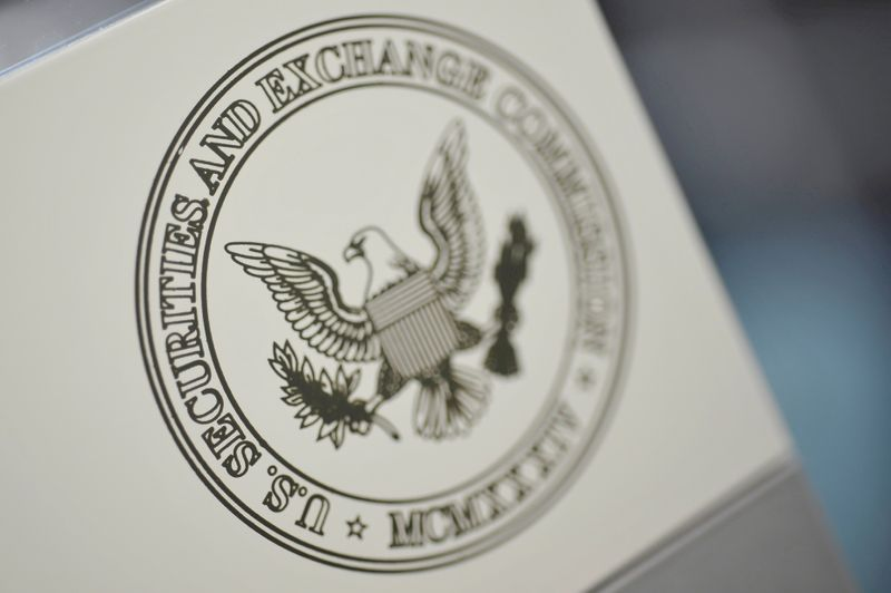 FILE PHOTO: FILE PHOTO: FILE PHOTO: The U.S. Securities and Exchange Commission logo adorns an office door