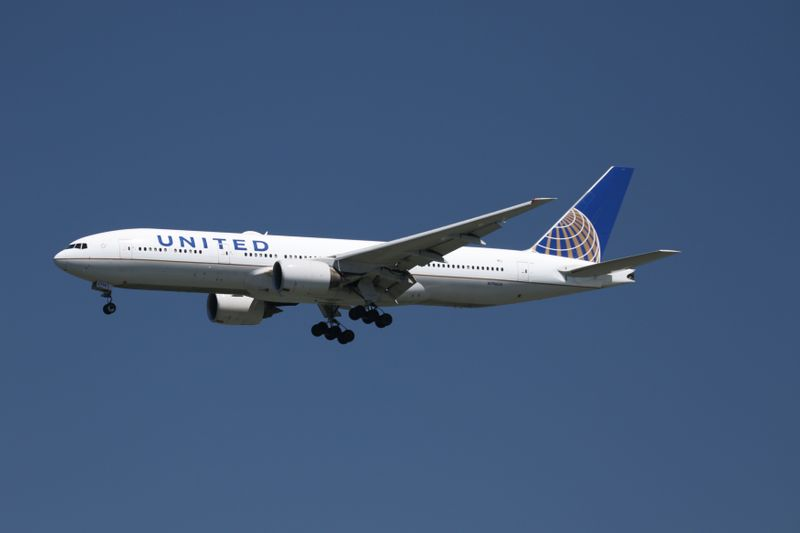 A United Airlines Boeing 777-200, with Tail Number N796UA, lands at San Francisco International Airport, San Francisco