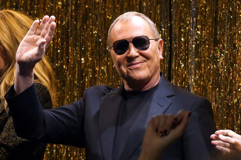 FILE PHOTO: Designer Michael Kors waves after presenting his collection during New York Fashion Week in New York