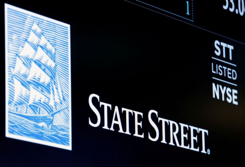 FILE PHOTO: The ticker and logo for State Street Corporation is displayed on a screen at the post where it's traded on the floor of the NYSE