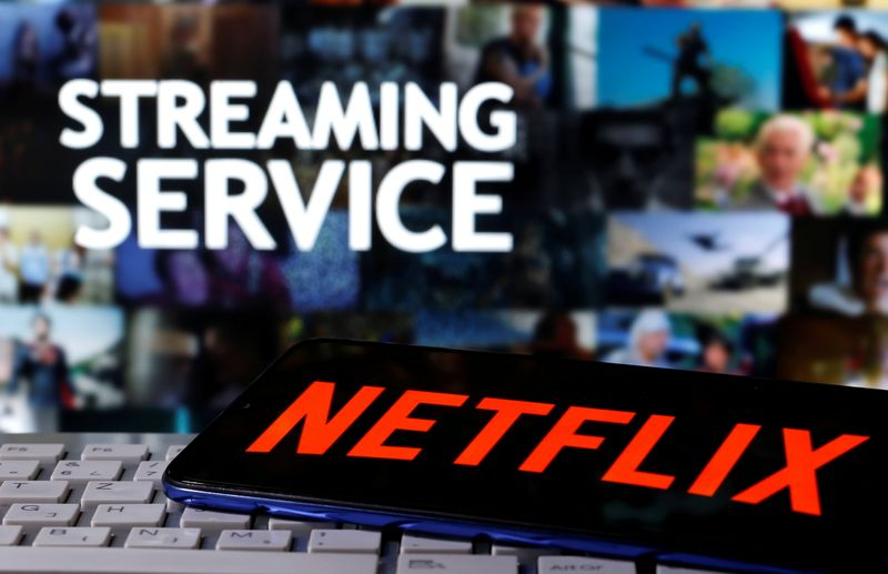 FILE PHOTO: A smartphone with the Netflix logo is seen on a keyboard in front of displayed
