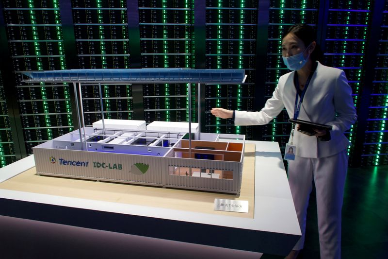 FILE PHOTO: Staff member introduces Tencent's Internet Data Center (IDC) cloud computing service during a government-organized media tour to Tencent headquarters in Shenzhen