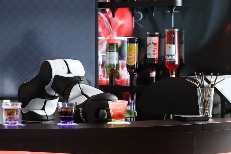 A robotic arm serves a Campari Soda at the Barney Cocktail Bar