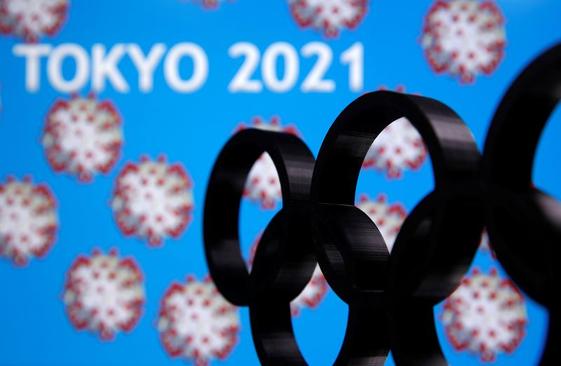 A 3D printed Olympics logo is seen in front of displayed
