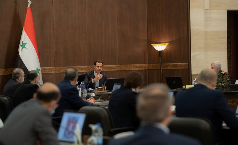 FILE PHOTO: Syria's President Bashar al-Assad meets with the Syrian cabinet in Damascus