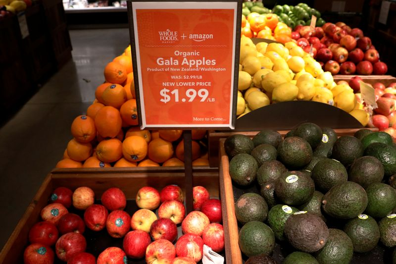 Apples and Avocados are displayed at a Whole Foods store in New York