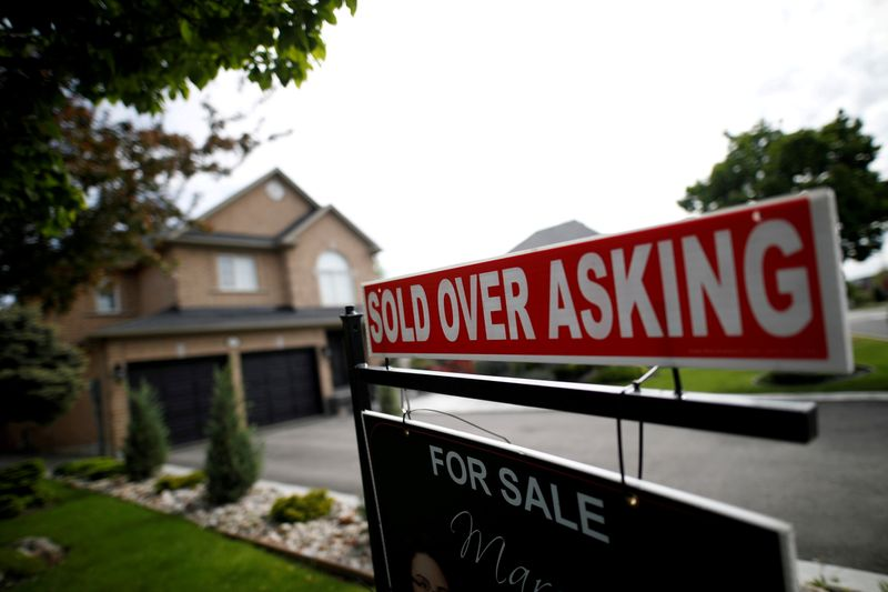 FILE PHOTO: A real estate sign that reads