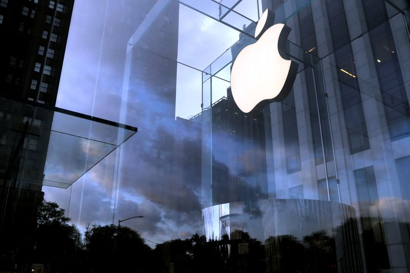 The Apple Inc. logo is seen hanging at the entrance to the Apple store on 5th Avenue in New York
