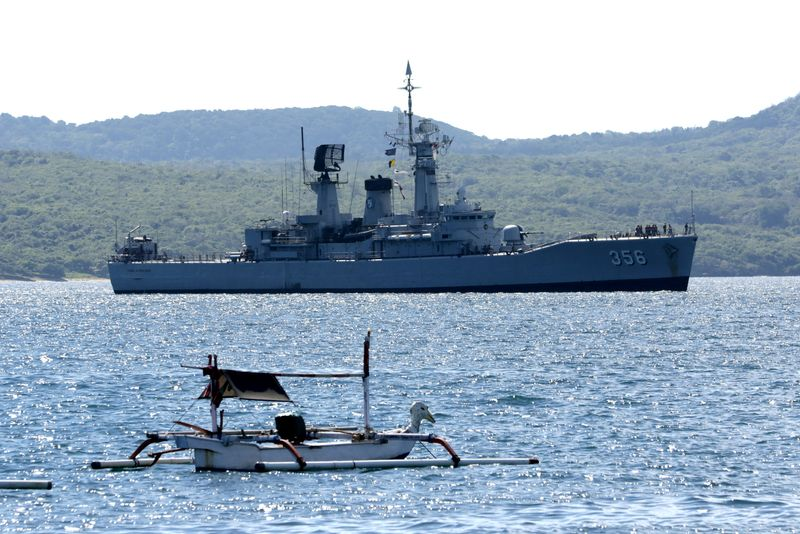 Indonesian Navy's KRI Karel Satsuitubun-356 is seen while preparing to dock at Tanjung Wangi port, as it is being prepared for rescue operation of the KRI Nanggala-402 that lost contact yesterday, in Banyuwangi