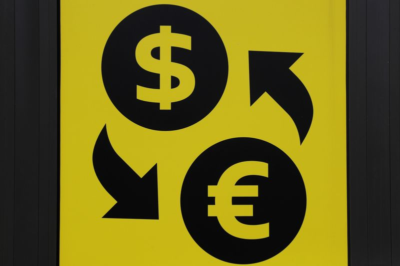 Currency signs of the U.S. dollar and Euro are seen at a currency exchange office in Kiev