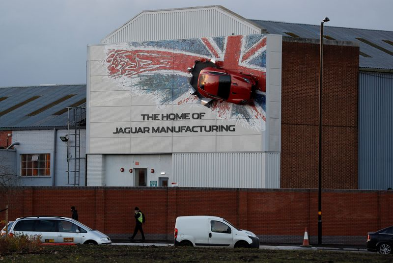 A car hangs on the wall of Jaguar's Castle Bromwich manufacturing facility in Birmingham