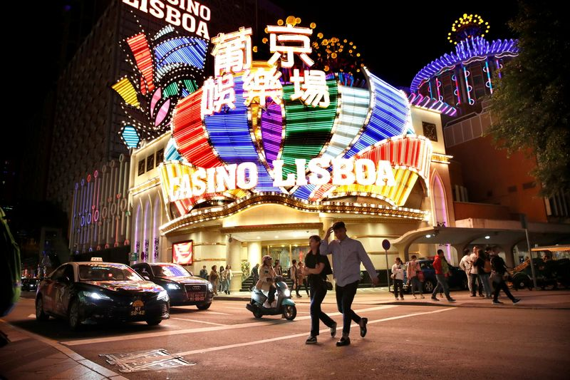 FILE PHOTO: People walk in front of Casino Lisboa in Macau